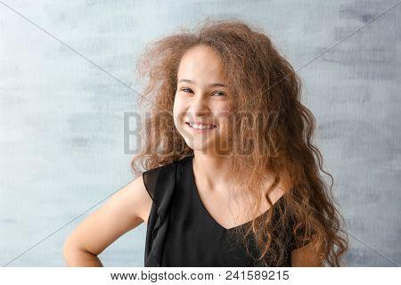 Stylish teenager against grey background