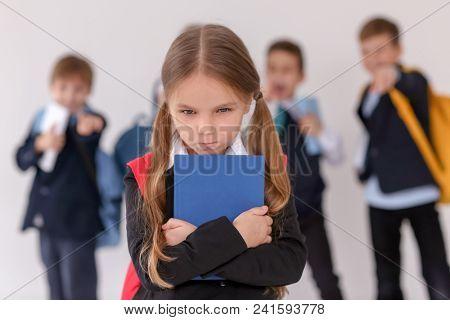 Children bullying their classmate on light background