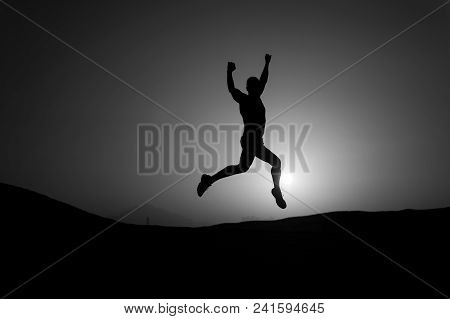 Freedom, Energy Concept. Athlete With Muscular Body In Dusk. Silhouette Of Sportsman. Sport, Fitness