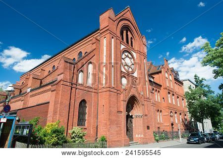 Berlin, Germany - May 31, 2017: Church Building With Red Brick Facade On Blue Sky. Church House On S