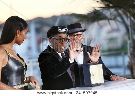 Barry Alexander Brown,  Laura Harrier,  Spike Lee attend the photocall the Palme D'Or Winner during the 71st Cannes Film Festival at Palais on May 19, 2018 in Cannes, France.