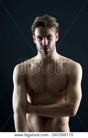 Sport Or Bodycare And Fitness Concept. Bodybuilder With Sexy Chest And Belly. Man Athlete With Fit T