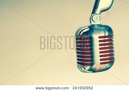 Silver Vintage Microphone With Red Membrane ?lose Up On A Grey Vintage Background