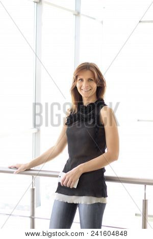Successful Business Woman With A Smartphone. Business Woman In Office