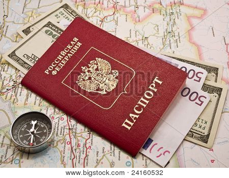 Passport with money,compass, map