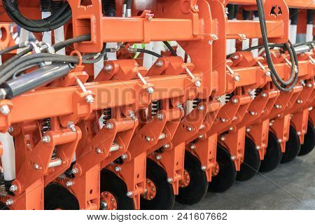 New, Modern Agricultural Machinery. Stubble Cultivator Close-up. Agricultural Machinery In Agricultu
