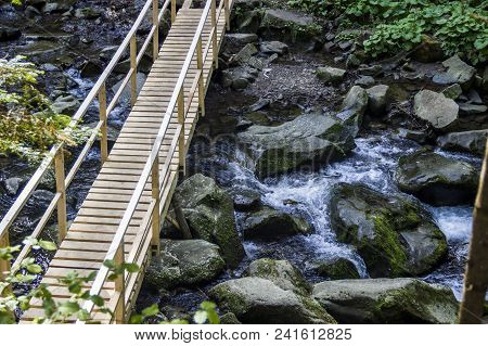Wooden Footbridge At The Kamianka River (a Right Tributary Of The Opir River) Near The Kamianetskyi