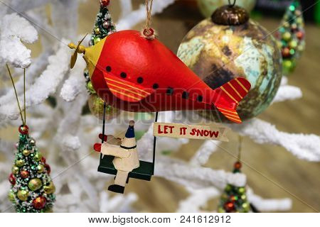 Christmas Robot Riding Red Blimp With Let It Snow Sign On White Fluffy Christmas Tree With Other Orn