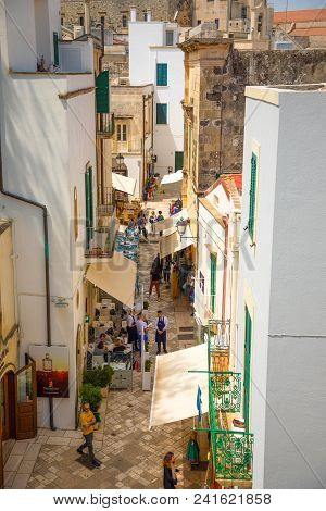 Otranto, Italy - 6.05.2018: People On Narrow Streets Of The Old Town In Otranto, Small Typical Alley