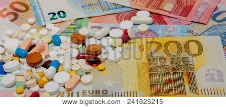 Money And Pills. Pills Of Different Colors On Money. Medicine Concept. Euro Cash.