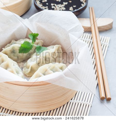 Steamed Korean Dumplings Mandu With Chicken Meat And Vegetables In Bamboo Steamer, Square
