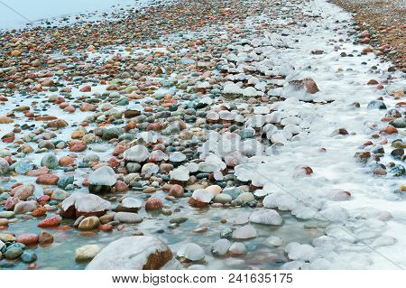 Icy Rocks On The Sea Shore, Ice On Rocks, Ice On Sea Rocks And Sand, Baltic Sea