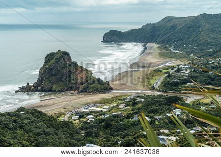 Aerial View Of Town On Seashore On Cloudy Day, Piha Beach, New Zealand