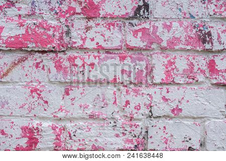 Abstract Dirty Painted Brick Surface Close-up, Pink Paint. Colorful Grunge Texture Of Wall. Abstract