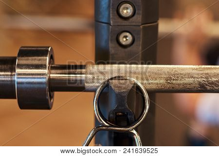 Close-up Image Of An Exercise Equipment Barbell Weights In Sports Gym.