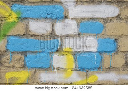 Several Painted Bricks In Blue, Yellow And White On An Old Dirty Wall, As Graffiti. Colorful Grunge
