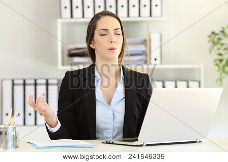 Stressed Executive Trying To Relax Doing Yoga At Office