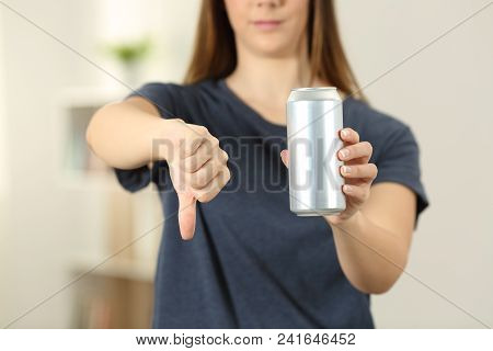 Front View Close Up Of A Woman Hands Holding A Soda Drink Can With Thumbs Down At Home