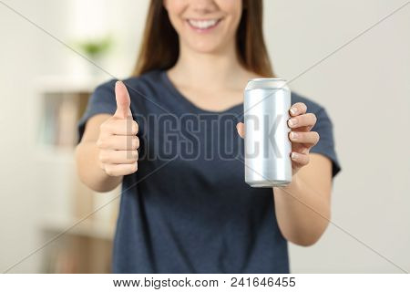 Front View Close Up Of A Woman Hands Holding A Soda Drink Can With Thumbs Up At Home