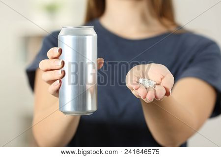Front View Close Up Of A Woman Hands Holding A Soda Drink Can And Saccharin At Home