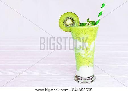 Kiwi Yogurt Smoothies Juice And Kiwi Green Fruit For Breakfast In The Morning  On White Wood.