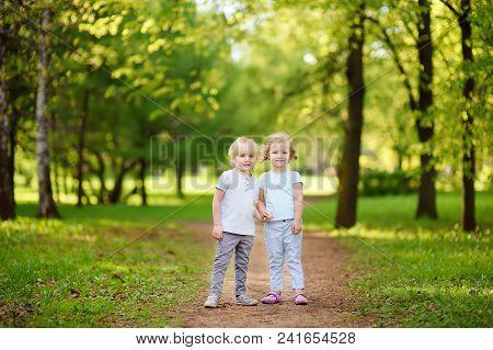 Cute Little Children Playing In Sunny Summer Park. Preschooler Boy And Girl. Best Friends.toddler Si