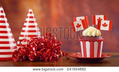 Red And White Theme Cupcakes With Canadian Maple Leaf Flags For First Of July Canada Day Or Canadian