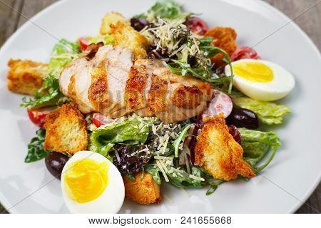 Caesar Salad With Fried Chicken Meat, Close Up. Mediterranean Cuisine, Side Dish, Appetizer, Banquet