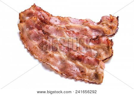 Slices of fried bacon isolated on white background