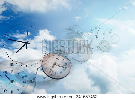 Clocks in blue sky. Time flies