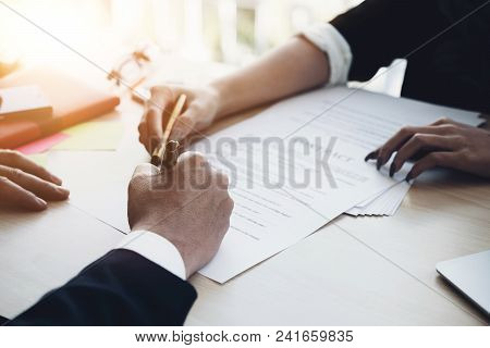 Close Up Business Man Signing Contract Making A Deal With Business Partner - Business Deal Concept
