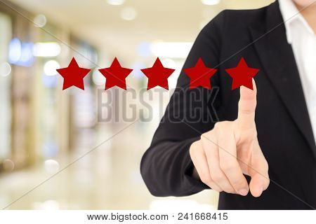 Businesswoman Hand Pointing Red Five Star Over Blur Background, Customer Excellent Rating Satisfacat