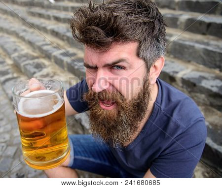 Guy Having Rest With Cold Draught Beer. Hipster On Cheerful Face Drinking Beer Outdoor, Raising Drin