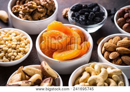 Assortment Of Nuts And Dried Fruits In Bowls. Dried Apricots, Cashew, Hazelnuts, Walnuts, Almonds, B