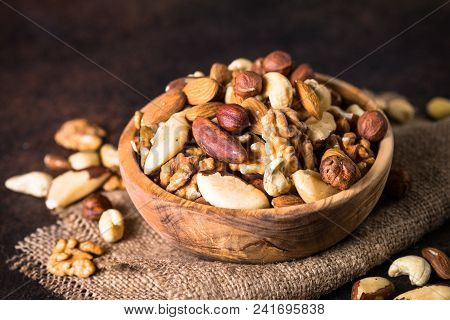 Assortment Of Nuts In Wooden Bowl. Cashew, Hazelnuts, Walnuts, Almonds, Brazilian Nuts And Pine Nuts