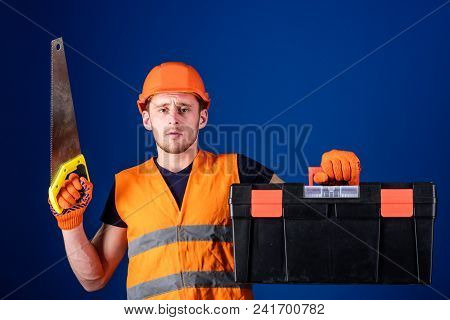 Carpenter Concept. Worker, Repairer, Repairman On Serious Face Carries Toolbox, Ready For Repair, Co