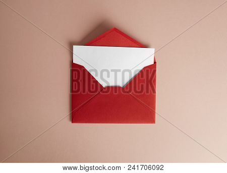 Mockup Envelope And White Blank Sheet On Empty Color Desk. Business Empty Mock-up Background For Mes