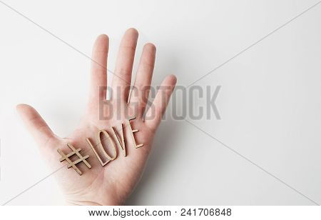 Mockup Of Love Message With Wooden Letters On Male Hand On Empty White Background. Business Mock-up
