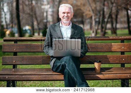 Fresh Idea. Confident Mature Businessman Using Laptop While Staring At Camera