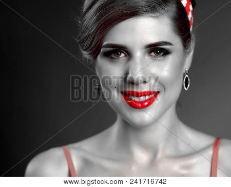 Pin up girl happy and smiling at party. Pin-up retro female style. Girl pin-up style wearing red dress. Black and white portrait of beautiful girl with red accent. Memories of past. Black and white