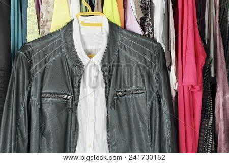 Green Leather Jacket And White Shirt In The Closet