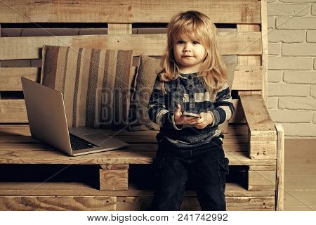 Child Childhood Children Happiness Concept. Kid At Computer With Cell Phone, Sms And 4g. Social Netw