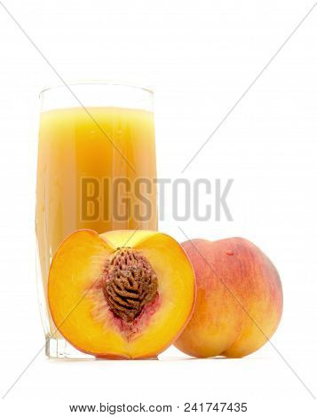 Peach Juice In A Glass With A Peach And Cut The Peach Near Isolated On White Background