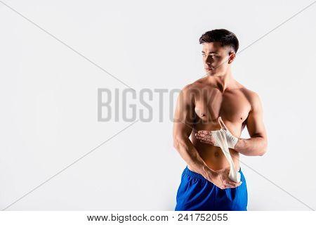 I'm In Tune Of Winning. Portrait Of Sportive Muscular Naked, Wearing Blue Shorts Bodybuilder, He Is