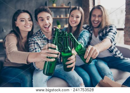 Four Friends, Two Couples Having Small Home Party, Meeting, Sitting On Couch, Clinking Bottles Of Be