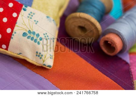 Patchwork, Quilting, Sewing, Tailoring And Fashion Concept - Close-up On Beautiful Colorful Stitched