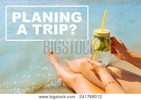 Planning A Trip. Woman Hold Cool Drink While Relaxing At Send Beach. Summer Vacation Concept