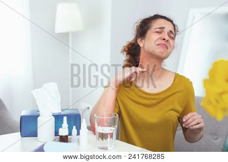 Metal intolerant. Young housewife wearing necklace feeling discomfort and pain discovering it causes her soreness and itchiness poster