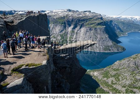Norway, Odda, rock formation Trolltunga, July 19, 2017: tourists in the queue to be photographed on the rock