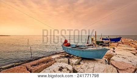 Fishing Boat Moored On Cliff At Sunset. Island Of Pellestrina, Venice,italy.